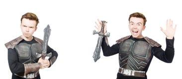 Il giovane uomo divertente nel vestito dell'armatura immagine stock libera da diritti