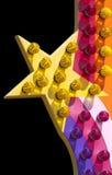 Il giro del parco di divertimenti illumina la stella Immagine Stock Libera da Diritti