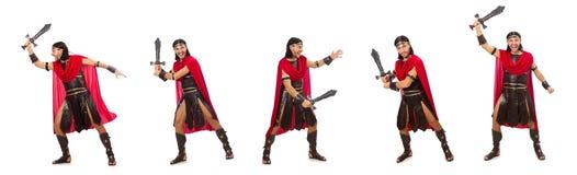 Il gladiatore che posa con la spada isolata su bianco Immagine Stock