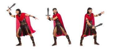 Il gladiatore che posa con la spada isolata su bianco Fotografie Stock Libere da Diritti