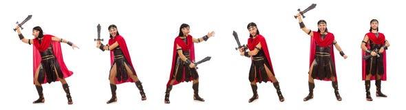 Il gladiatore che posa con la spada isolata su bianco Fotografia Stock