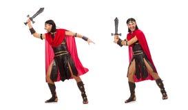 Il gladiatore che posa con la spada isolata su bianco Fotografia Stock Libera da Diritti