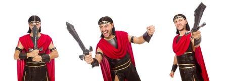 Il gladiatore che posa con la spada isolata su bianco Fotografie Stock