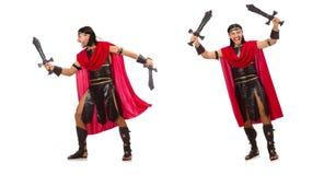 Il gladiatore che posa con la spada isolata su bianco Immagini Stock