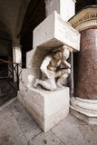 Il Gobbo di Rialto, statue of hunchback in Venice, Italy. Il Gobbo stands in the Rialto market, Venice, Italy, since the sixteenth century. Used as a podium for Stock Photography