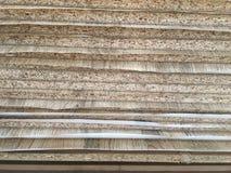 Il grano e la melammina di legno sorgono sulla vista laterale Fotografia Stock