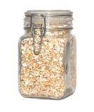 Il granulo si sfalda in vaso di vetro isolato Fotografia Stock Libera da Diritti