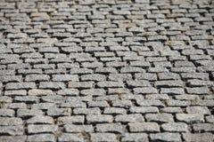 Il grey del granito cobbles il fondo astratto immagine stock libera da diritti