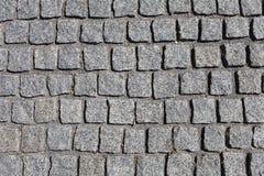 Il grey del granito cobbles il fondo astratto fotografia stock libera da diritti