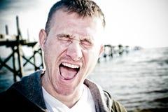 Il grido: Un uomo di Upset fotografia stock