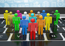 Il gruppo di persone dipende il computer portatile Fotografia Stock