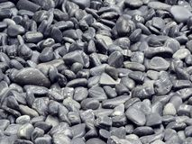 Il gruppo di piccola pietra rotonda grigia nera di zen per la decorazione ha strutturato gli ambiti di provenienza immagini stock
