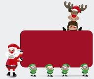 Il gruppo di Santa con la carta del segno Fotografia Stock