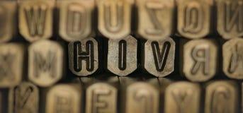 Il HIV ha compitato dalla perforazione dell'alfabeto del bollo del metallo Immagine Stock Libera da Diritti