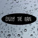 Il ` ispiratore di citazione gode del ` della pioggia Fotografie Stock Libere da Diritti