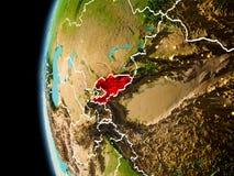 Il Kirghizistan da spazio nella sera Immagini Stock