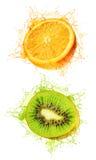 Il Kiwi ed arancioni hanno bagnato Fotografia Stock