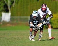 Il Lacrosse affronta fuori Immagini Stock Libere da Diritti