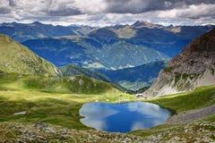 Il lago Obstanser vede, cresta principale delle alpi di Carnic, Tirolo orientale, Austria Fotografia Stock Libera da Diritti