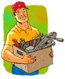 Il lavoratore sorridente sta tenendo una cassetta portautensili Immagine Stock Libera da Diritti