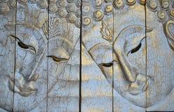 Il legno di scultura del fronte del Buddha immagini stock libere da diritti