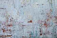 Il lerciume ha arrugginito struttura del metallo, fondo ossidato blu-grigio del metallo Vecchio pannello del ferro del metallo su fotografia stock libera da diritti