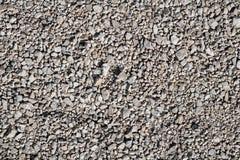 Il lerciume ha invecchiato la struttura della superficie di messa a terra della ghiaia in cattivo stato fotografia stock libera da diritti