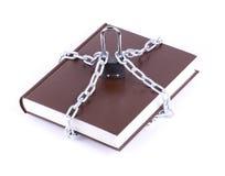 Il libro marrone è catena a maglia e lucchetto Fotografie Stock
