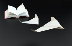 Il libro pagina il volo come di aerei di carta Fotografia Stock