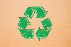 Il logo ricicla su fondo di carta Immagini Stock
