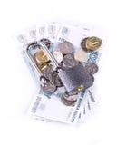 Il lucchetto sulle monete e sulle banconote Fotografia Stock Libera da Diritti