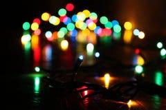Il ` luminoso s del nuovo anno accende la macro Fotografie Stock Libere da Diritti
