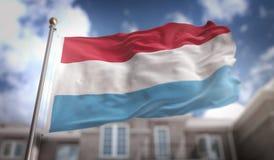 Il Lussemburgo inbandiera la rappresentazione 3D sul fondo della costruzione del cielo blu Fotografia Stock