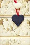 Il macro retro incrocio ha elaborato l'immagine di effetto di cuore sulla parte posteriore di legno fotografie stock