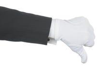 Il maggiordomo che fa i pollici giù gesture fotografie stock