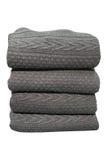 Il maglione grigio ha piegato la pila isolata su fondo bianco Fotografia Stock Libera da Diritti