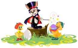 Il mago ed i polli del coniglio hanno tinto le uova per Pasqua Fotografia Stock Libera da Diritti