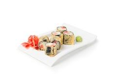 Il maki dei sushi rotola sul piatto immagini stock libere da diritti