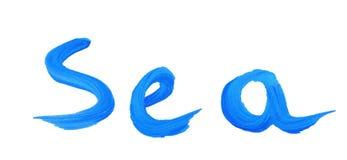 Il mare scritto nei colori blu su un bianco ha isolato il fondo Fotografie Stock Libere da Diritti