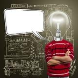 Il maschio nel colore rosso e la lampada-testa con discorso bollono Fotografie Stock Libere da Diritti