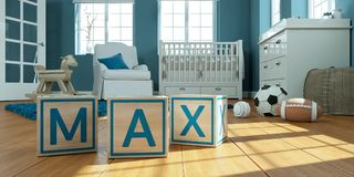 Il massimo di nome scritto con i cubi di legno del giocattolo nella stanza del ` s dei bambini Immagini Stock Libere da Diritti