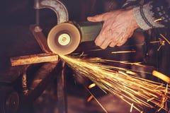 Il Master di saldatura cuce la smerigliatrice di angolo Fotografie Stock