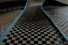 Il materiale automobilistico fa dal composto della fibra del carbonio fotografia stock libera da diritti