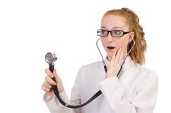 Il medico abbastanza femminile con lo stetoscopio isolato Fotografia Stock