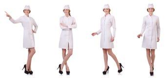 Il medico attraente della donna isolato su bianco Fotografie Stock