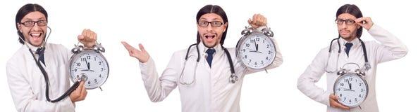 Il medico dell'uomo con l'orologio isolato su bianco Fotografia Stock