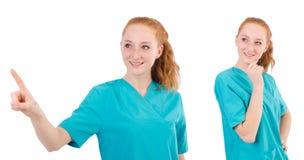 Il medico della donna in uniforme che sfoglia su isolato su bianco Fotografia Stock