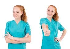 Il medico della donna in uniforme che sfoglia su isolato su bianco Fotografie Stock Libere da Diritti
