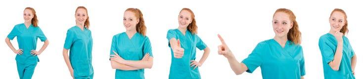 Il medico della donna in uniforme che sfoglia su isolato su bianco Fotografia Stock Libera da Diritti