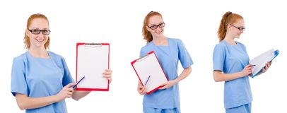 Il medico grazioso in uniforme del blu con i documenti isolati su bianco Fotografia Stock Libera da Diritti